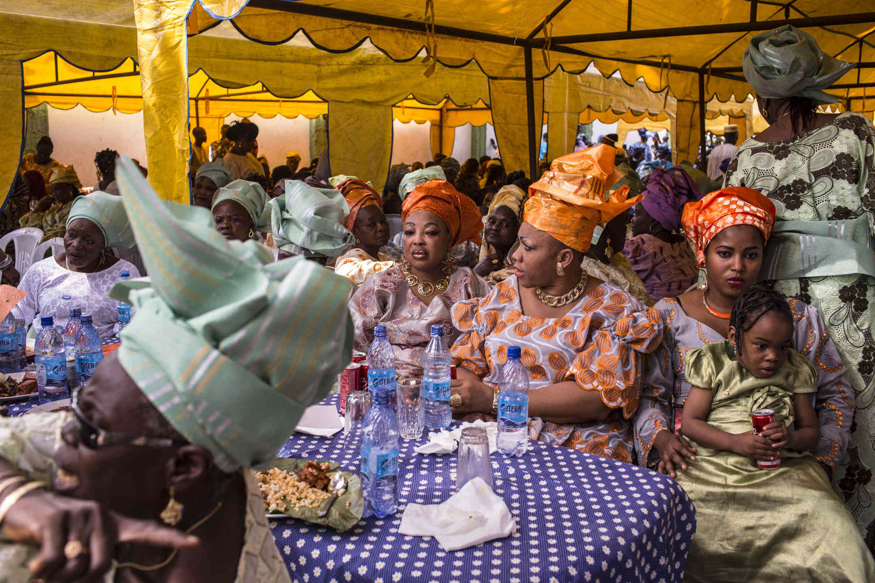 Guests at a wedding in Lagos await the start of the ceremony and lunch. The wedding industry in petrol-rich Nigeria is big business.