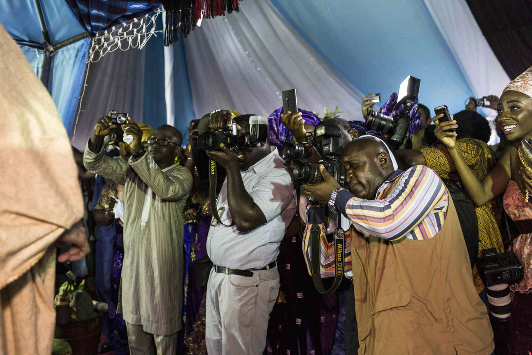 Paparazzi photograph Monica Mark and her husband, the daughter of the President of the Nigerian Senate, in Benue State, Nigeria.