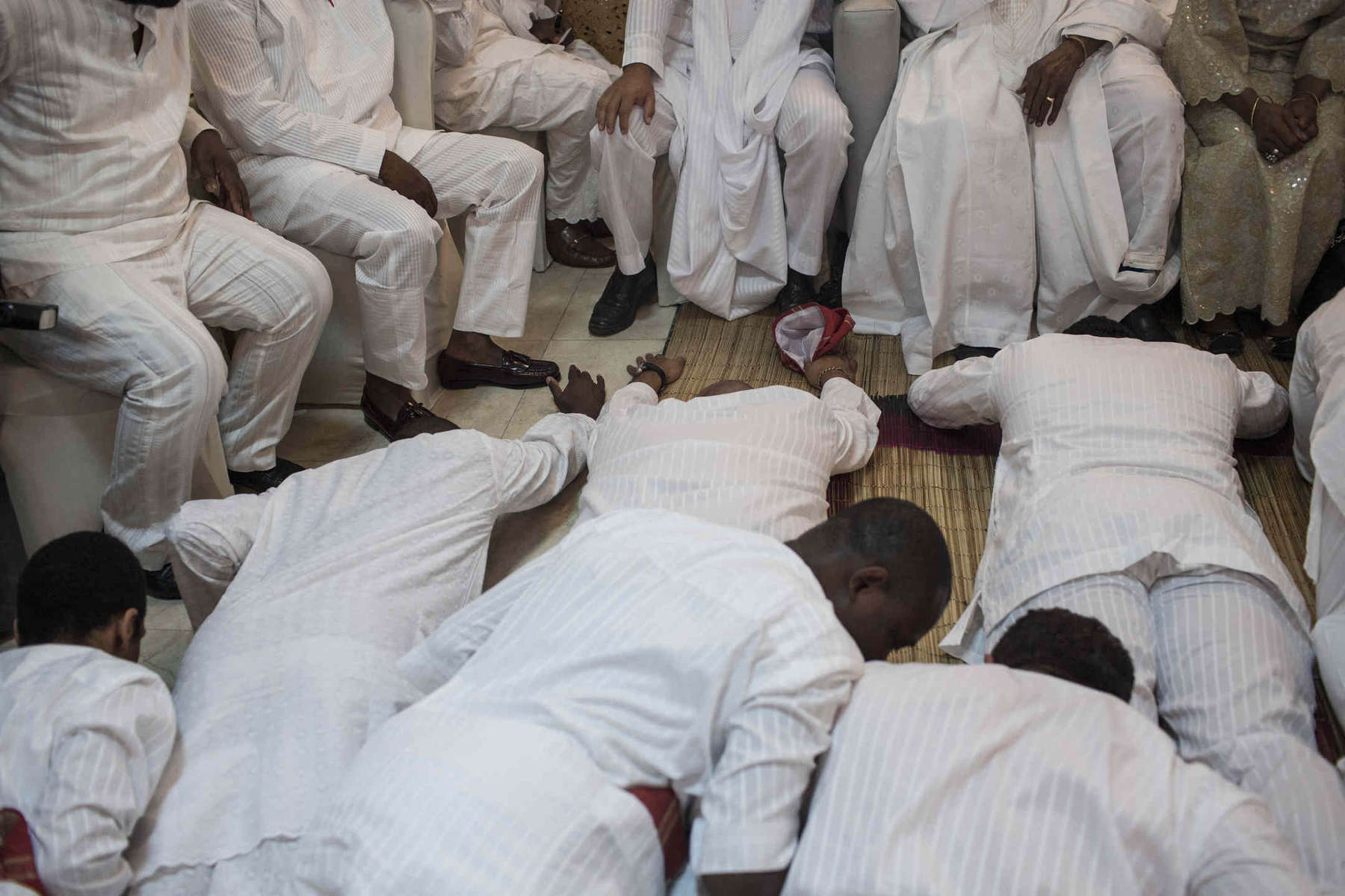The groom and his groomsmen must prostrate themselves in front of the bride's family before they accept him.