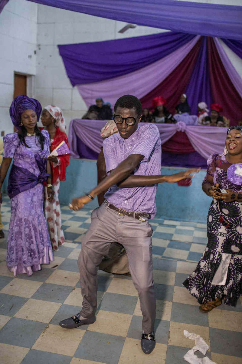 A man dances at the lady's part of a Muslim wedding in Jos, Nigeria.