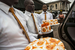 A disassembled cake is brought to a wedding in Lagos, Nigeria.