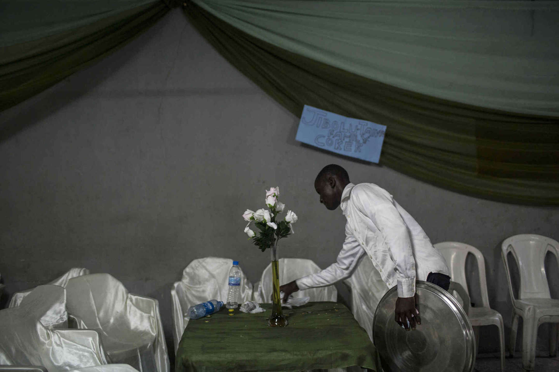 A waiter clears the table at the end of a wedding in Lagos in October 2012.  The wedding industry in petrol-rich Nigeria is big business.