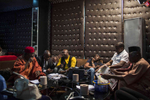 Producers and actors go over a script on set at a Nollywood movie being filmed in Lagos.