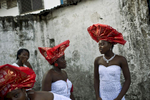 Bridesmaids wear matching red hats and dresses made from a local fabric called {quote}lace{quote} on November 13, 2011. The freed American slaves who founded modern Liberia built an unequal society. Generations of resentment and disenfranchisement led to a civil war that Liberia is still recovering from.Photo by @glennagordon #Liberia #Africa #WestAfrica #EverydayAfrica #antebellum #monrovia #wedding #lace #slum