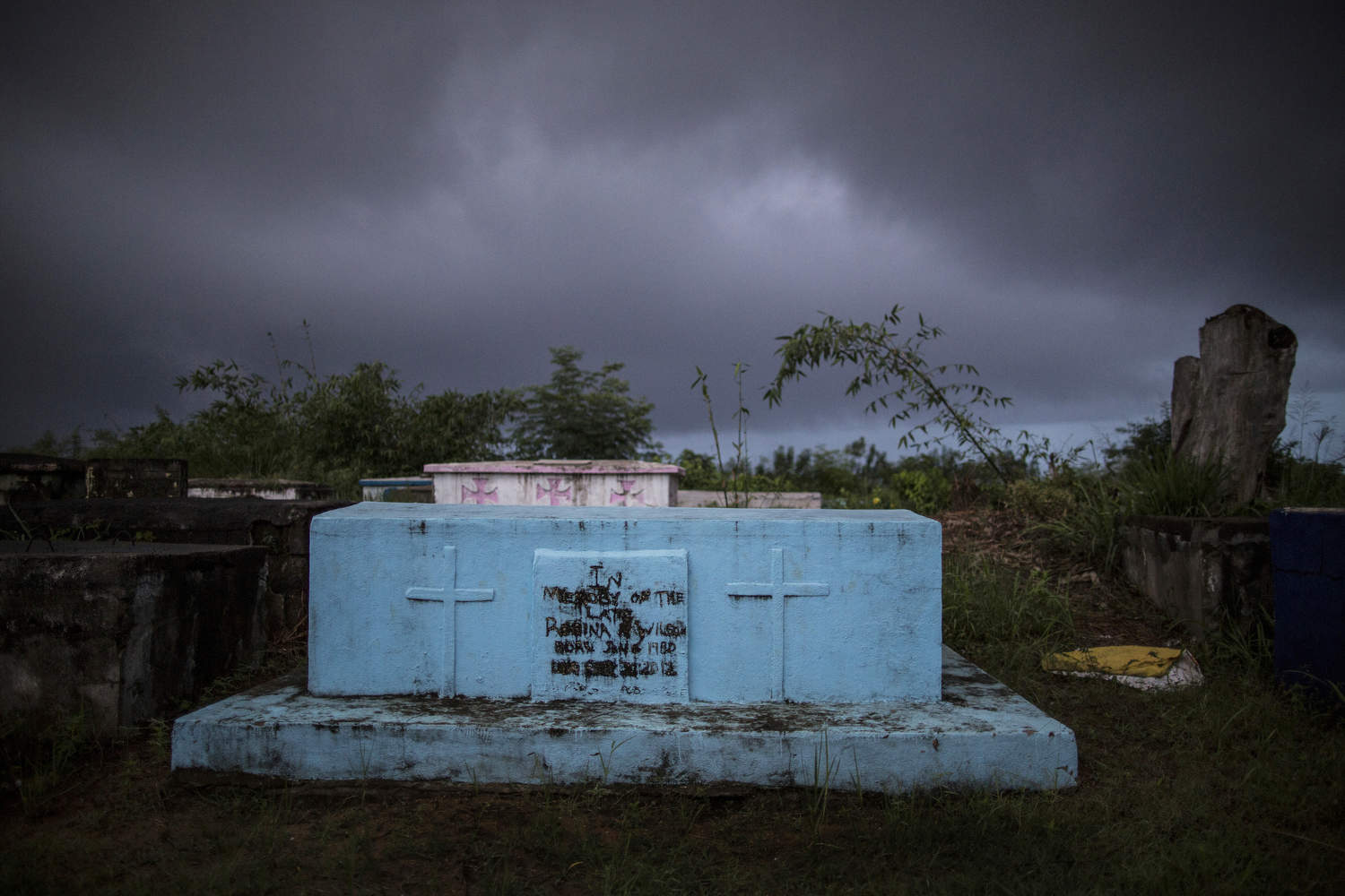 The graveyard in southeast Liberia right before a rain storm. Harper was once beautiful and prosperous, but the remote town now only has signs of better times. Photo by @glennagordon for @smithsonianmag#Liberia #Africa #WestAfrica #EverydayAfrica #antebellum #architecture #Harper #remote #seaside #decay #traces