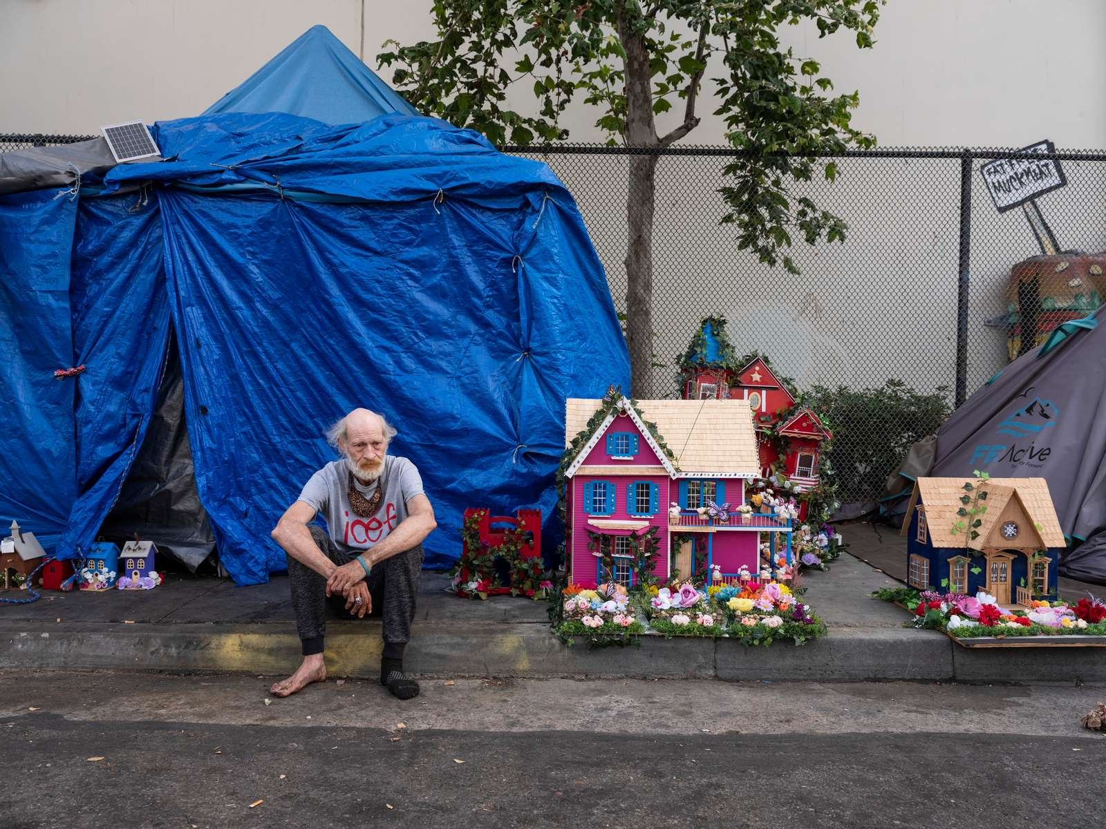 Kenny Goins lives in the encampment on Third Ave, near the offices of Google and expensive real estate, and builds doll houses and bird houses that he sells.