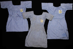 Chibok girl's school uniforms. One was clearly made in a hurry, in messy stitching and different color threads. Another one was well made but utilitarian – probably stitched by the girl's mother. Another dress was especially dirty and threadbare.  Maybe the girl was going to wash it tomorrow. Maybe she couldn't afford soap and was waiting until she could. It'd been stitched again and again at the sides – torn and repaired, probably the only uniform she had.