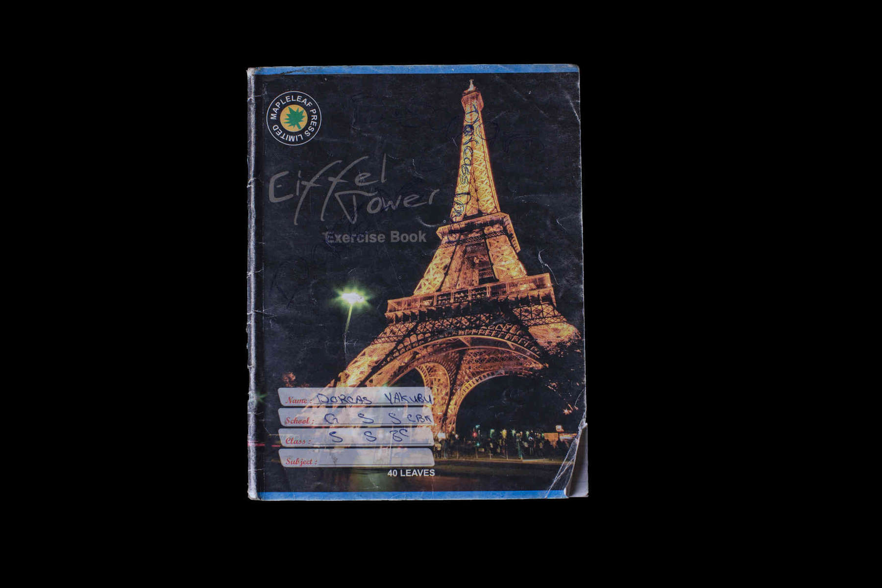 Dorcas Yakubu is 16 years old. Her parents describe her as  shy girl who loved eating tuwo (a local dish). The cover of her notebook has the Eiffel Tower on it.