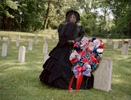 "Tara Bradley poses for a portrait in her official ""mourning gear"". She is a member of a group called the Order of the Confederate Rose. Though similar to groups like Daughters of the Confederacy, members of this group insist that they are not political and are open to all people. . On April 21, the group laid wreathes at a Confederate cemetery in Raymond, Mississippi for Confederate Memorial Month. The keynote speaker from the local Sons of Confederate Veterans group mentioned Hitler, the KKK and David Duke in his speech. One member of the Roses left in the middle, but it was later discovered that she did not leave in protest but because her feet hurt. After the ceremony, when pushed on dressing up as confederate slaveholders, members repeated false statistics like only 5 percent of Southerners owned slaves (in Mississippi, it was 55 percent), and argued that people also dress up as Union soldiers. When it was pointed out that no one dresses up like slaves, one woman exclaimed, """"We'd love to have someone that would!"" All of the women present boasted about volunteer work and civic duty and none thought their costumes or activities were racists or offensive. Groups like the OCR help keep the traditions of the Confederacy – and it's racists policies – alive and well."
