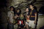 Family members pose for selfies and portraits after a burial in a cave in Toraja, a remote part of Indonesia. Funerals are not only sorrowful but also include joy and celebration of life and entrance to the afterlife. Because they often take place even years after someone has died, the emotional tenor is different than in the immediate aftermath of death.