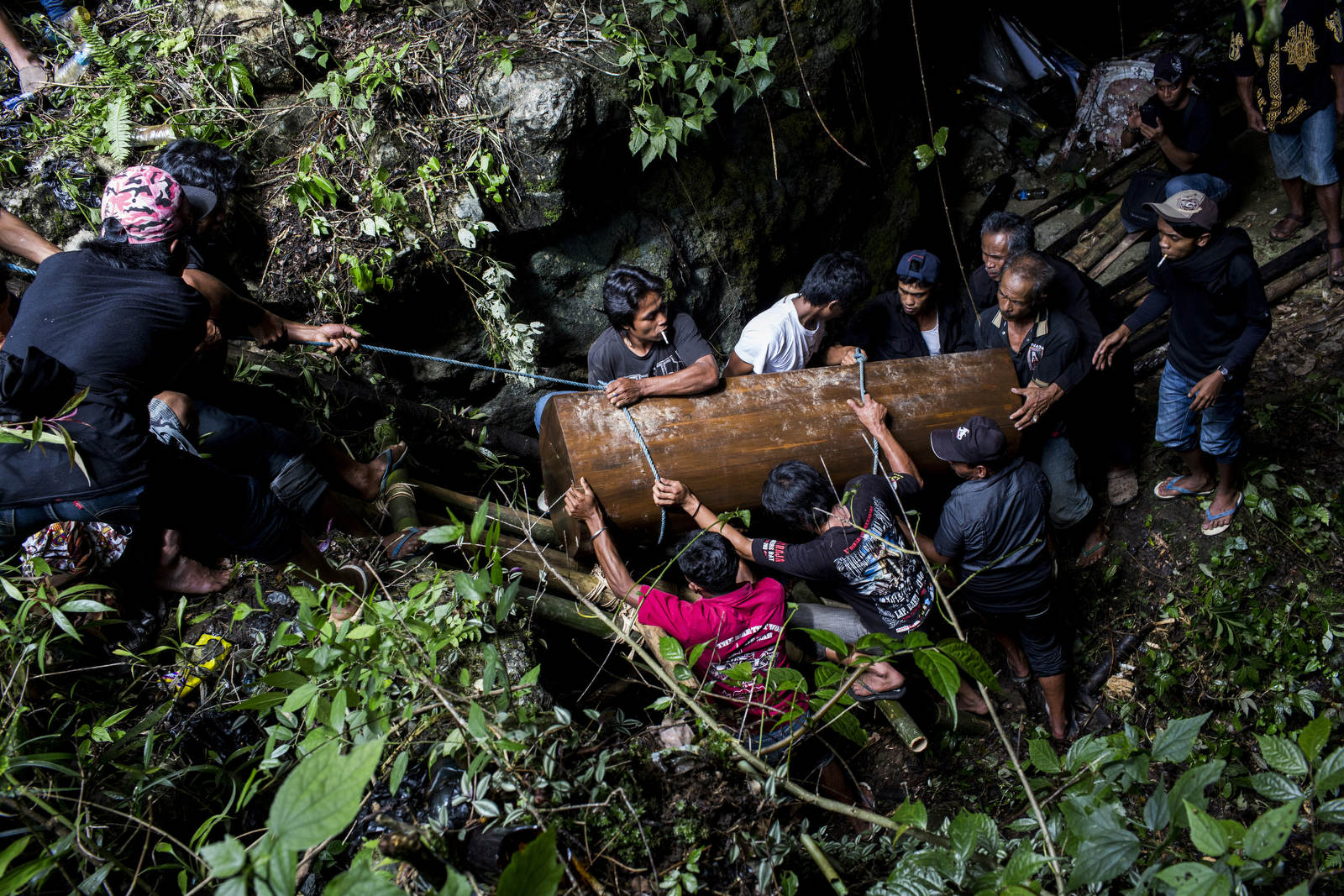 Men lower a coffin into a cave in Toraja, a remote part of Sulawesi. There are no traditional graveyards in the region, and instead, people are buried in caves, in carved out caverns in the faces of rocks, or in mini mausoleums in rice paddy fields, so that the deceased is closer to nature and can enter the afterlife.
