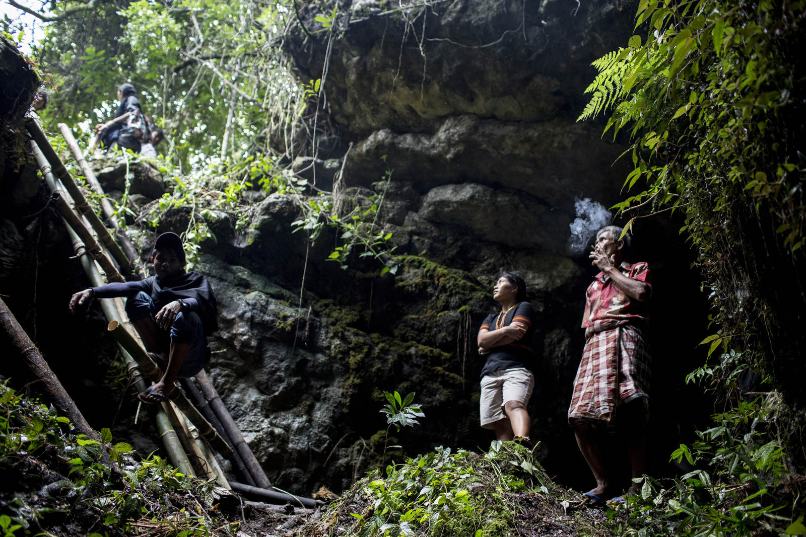 A man smokes a cigarette after a cave burial in Toraja, a remote part of Sulawesi. There are no traditional graveyards in the region, and instead, people are buried in caves, in carved out caverns in the faces of rocks, or in mini mausoleums in rice paddy fields, so that the deceased is closer to nature and can enter the afterlife.