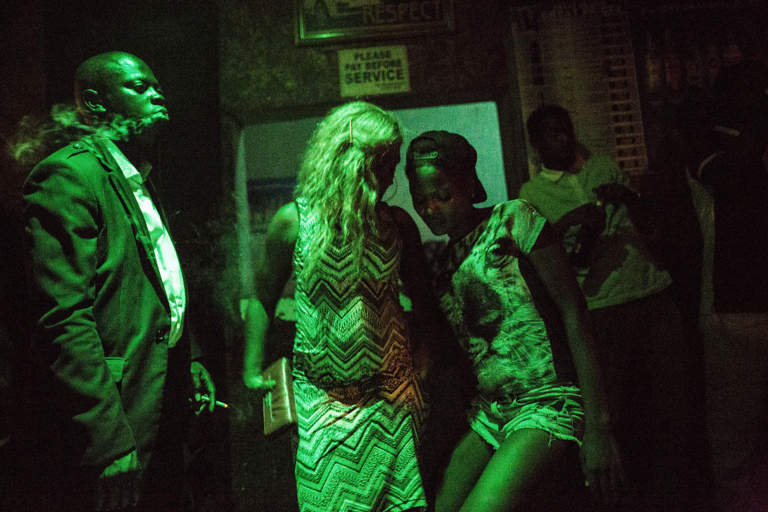 Sex workers dance at a bar in Obalende, a rough neighborhood in Lagos, Nigeria.