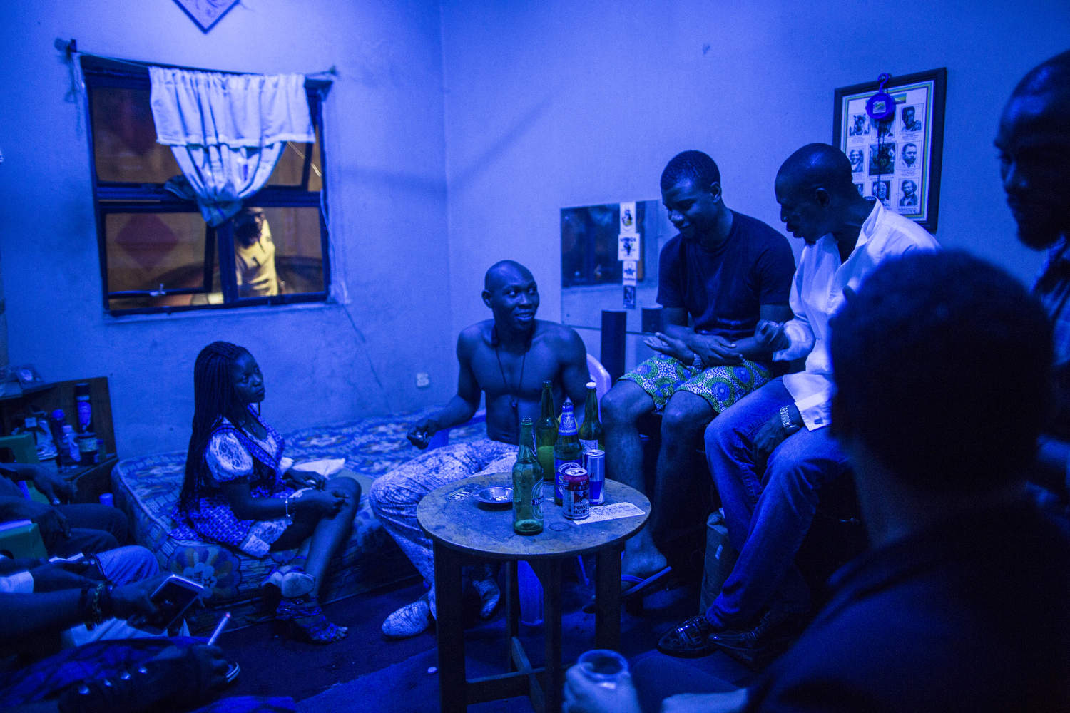 Seun Kuti, one of Fela's youngest sons, hangs out backstage after a show. Though he is less popular than his elder brother Femi, many say his music is closer to Fela's original beats.