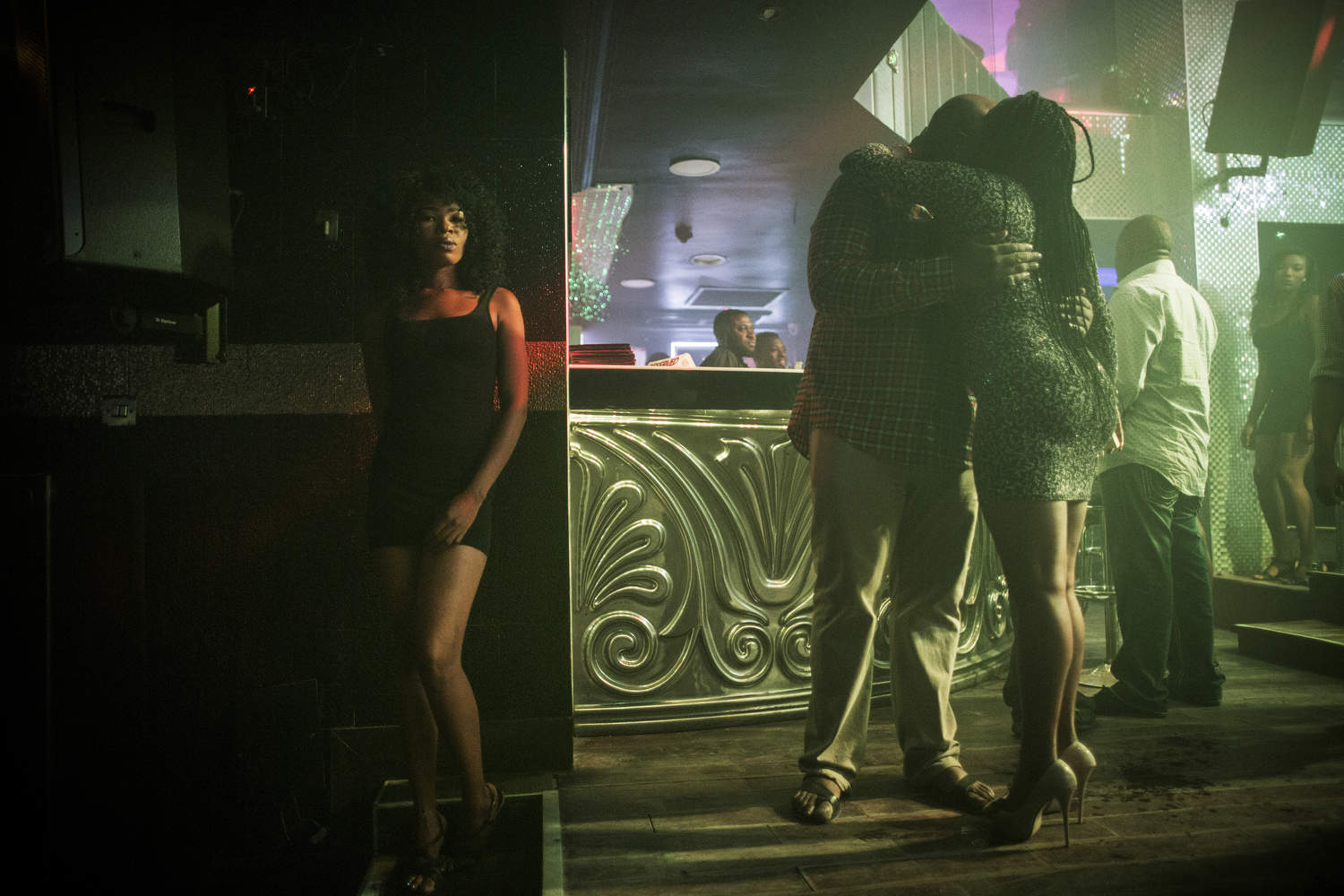 A waitress waits by the wall at Quilox, a popular nightspot in Victoria Island, Lagos's poshest neighborhood.