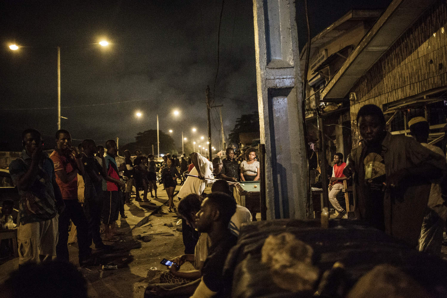 The streets of Obalende, a rough neighborhood in Lagos, are packed at night with young people looking for a good time and girls looking to make some money.