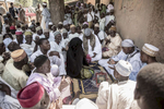 The wedding Fatiah, or ceremony, of Maryan Nazifi, in Dawakin Tofa, another small town outside of Kano, Northern Nigeria. Girls like Maryan rarely interact with men other than their relatives so to sit in front of all of the men of her village and receive their blessings is a moment of contract and prayer.