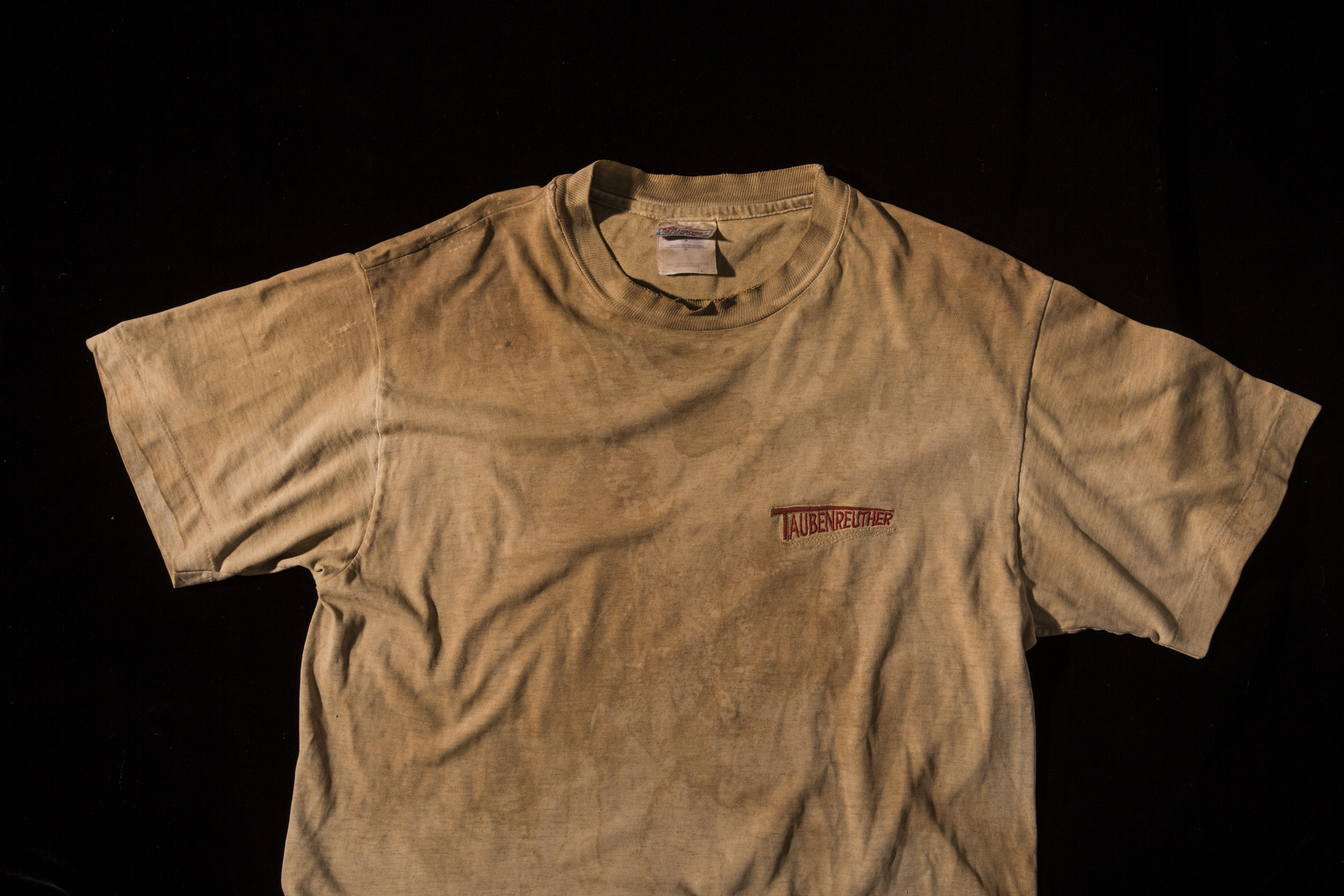 Harald Ickler was wearing this tshirt when he was taken hostage by al Al Qaeda affiliated terrorist group in the Saharah desert in 2003. The shirt was originally grey, but turned brown and was soon covered with sweat and stains as he wore it every day during his 54 day captivity. He never washed it, and even more than a decade later, the shirt still retained a distinct odor.