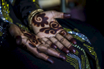 Later I went into the women's section, where I photographed her relatives and her henna'ed hands and feet. She was so young and so beautiful, all made up and perfumed on this occasion.