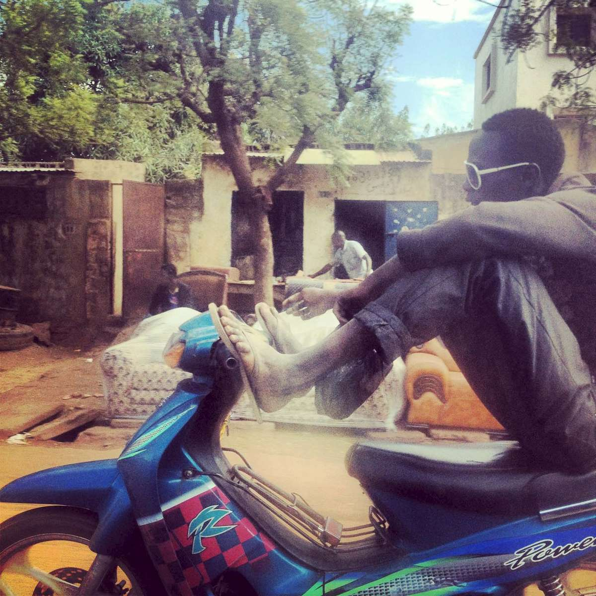 Motorbike antics. Bamako, Mali. January 2013.
