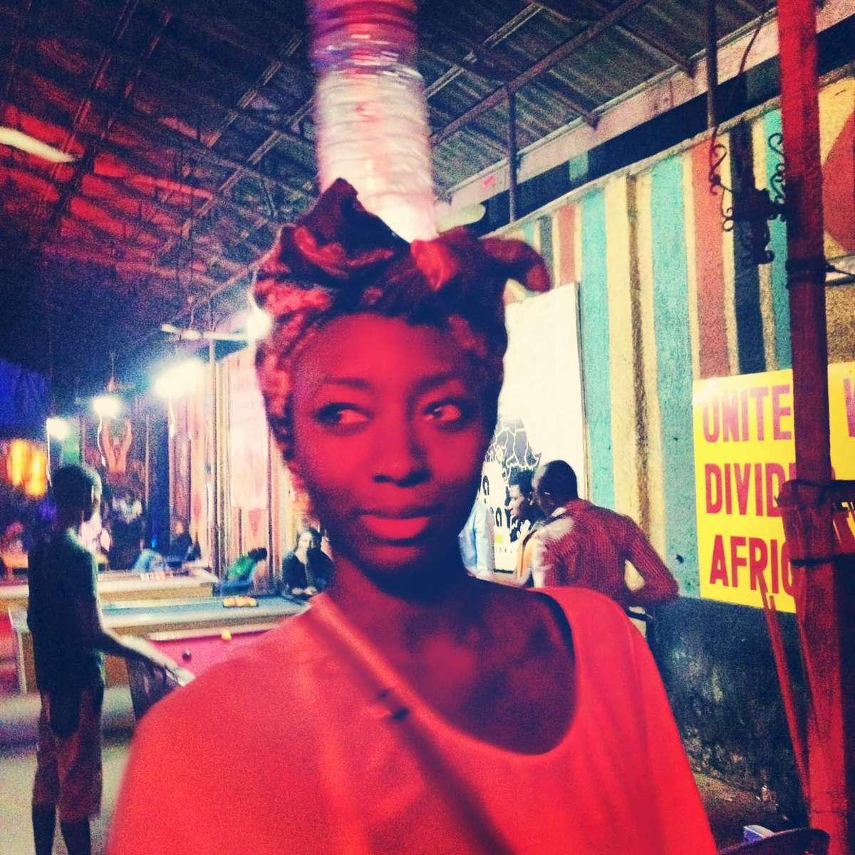Zainab balances a water bottle at the Shrine, a nightclub in Ikeja, on the mainland of Lagos, Nigeria. September 2012.