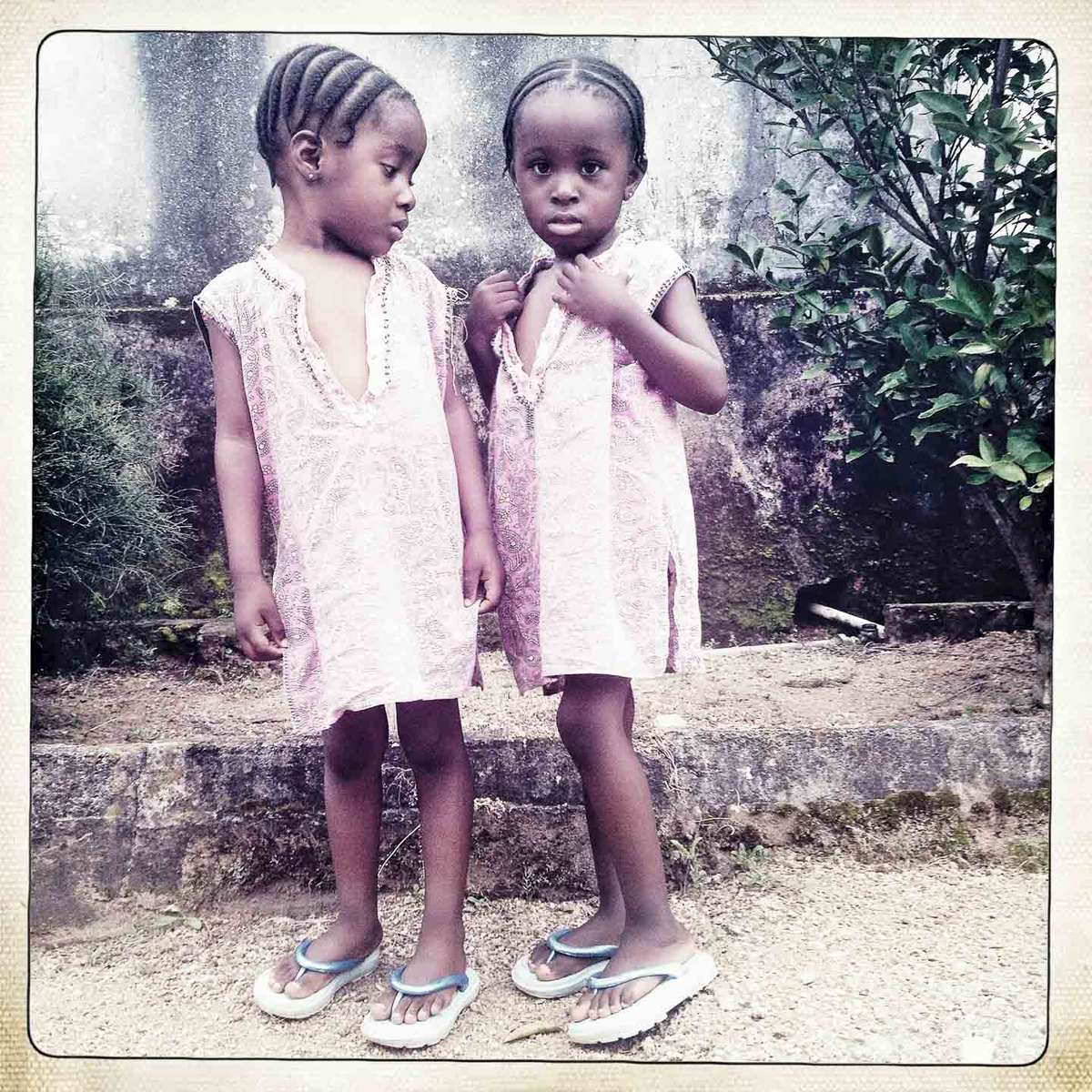 Twins named Flavor and Spice in Jos, Central Nigeria. September 2013.