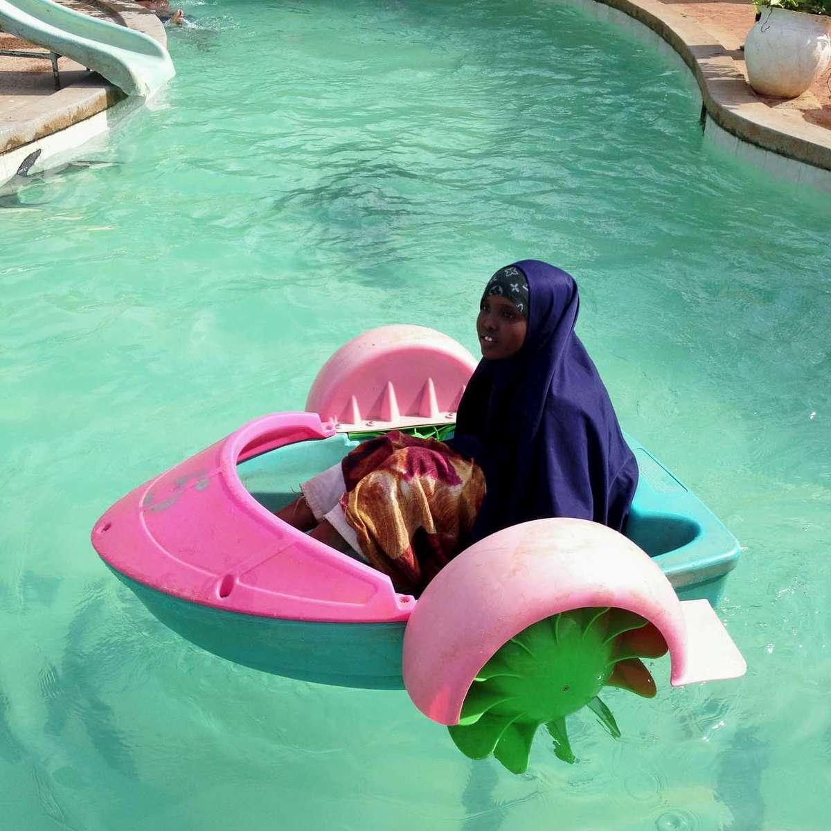 A Somali refugee plays at a water park on family day in Nairobi, Kenya. November 2013.
