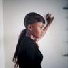 Yah\'s new hair do. Monrovia, Liberia. January 2014.