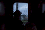 A passenger looks out the train window at Ibadan, the first big city outside of Lagos.