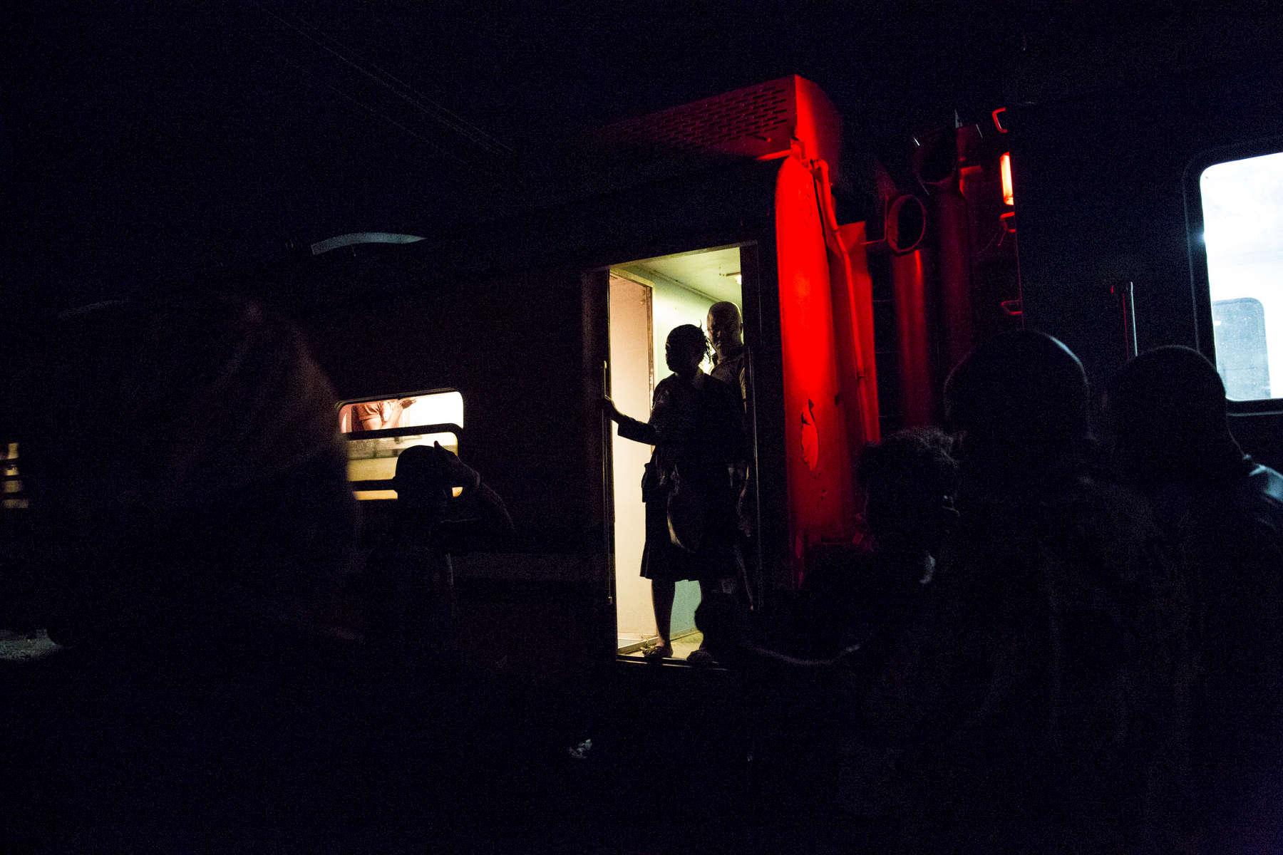 The train stops at Kaduna, the biggest city before Kano, just past dark.