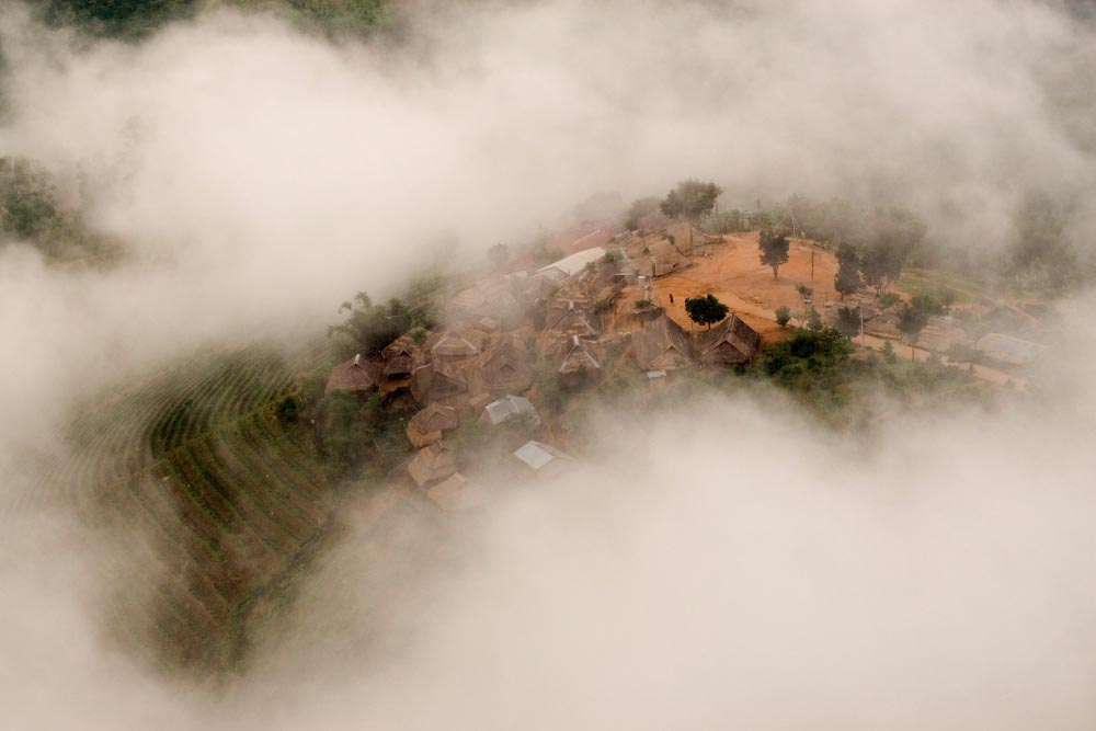 An Akha minority village viewed through clouds in Northern Thailand.