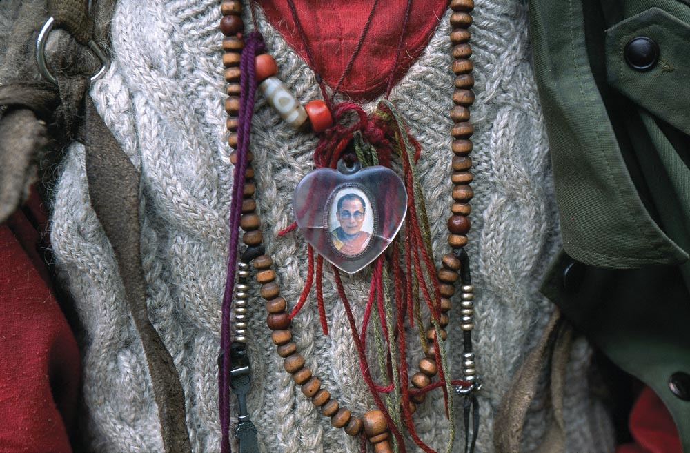 A Tibetan pilgrim wears a special pendant during the pilgrimage of Kawaparpo.Eastern Tibet, China