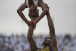 Guinean acrobats perform at a ceremony to mark Sierra Leone's 50th anniversary of independence from Britain at the National Stadium in the country's capital Freetown. Guinea borders Sierra Leone and the Guinean president came to the ceremony in Freetown. REUTERS/Simon Akam (SIERRA LEONE).