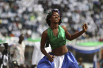 A dancer dressed in Sierra Leone's national colours of green, white and blue at a ceremony to celebrate the country's 50th anniversary of independence from Britain at the National Stadium in the capital Freetown. REUTERS/Simon Akam (SIERRA LEONE).