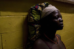 Maduu Kargbo sits with a bandaged head at the community health centre in the town of Bumbuna in central Sierra Leone. Beaten by police during a land dispute, the mother of five was barely able to speak. REUTERS/Simon Akam (SIERRA LEONE).