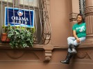 LaShawndra Thorton, a student at the Mailman School of Public Health, sits outside a historic brownstone house in Harlem on election day. The neighbourhood, the upper swathe of Manhattan island, is the traditional hub of African American culture in the United States. (Simon Akam)