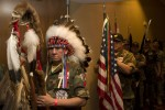 Native American war veterans, dressed in a combination of combat fatigues and traditional ceremonial regalia, wait to parade at the American Indian Inaugural Ball in the Washington DC suburb of Crystal City. (Simon Akam/The New Statesman)