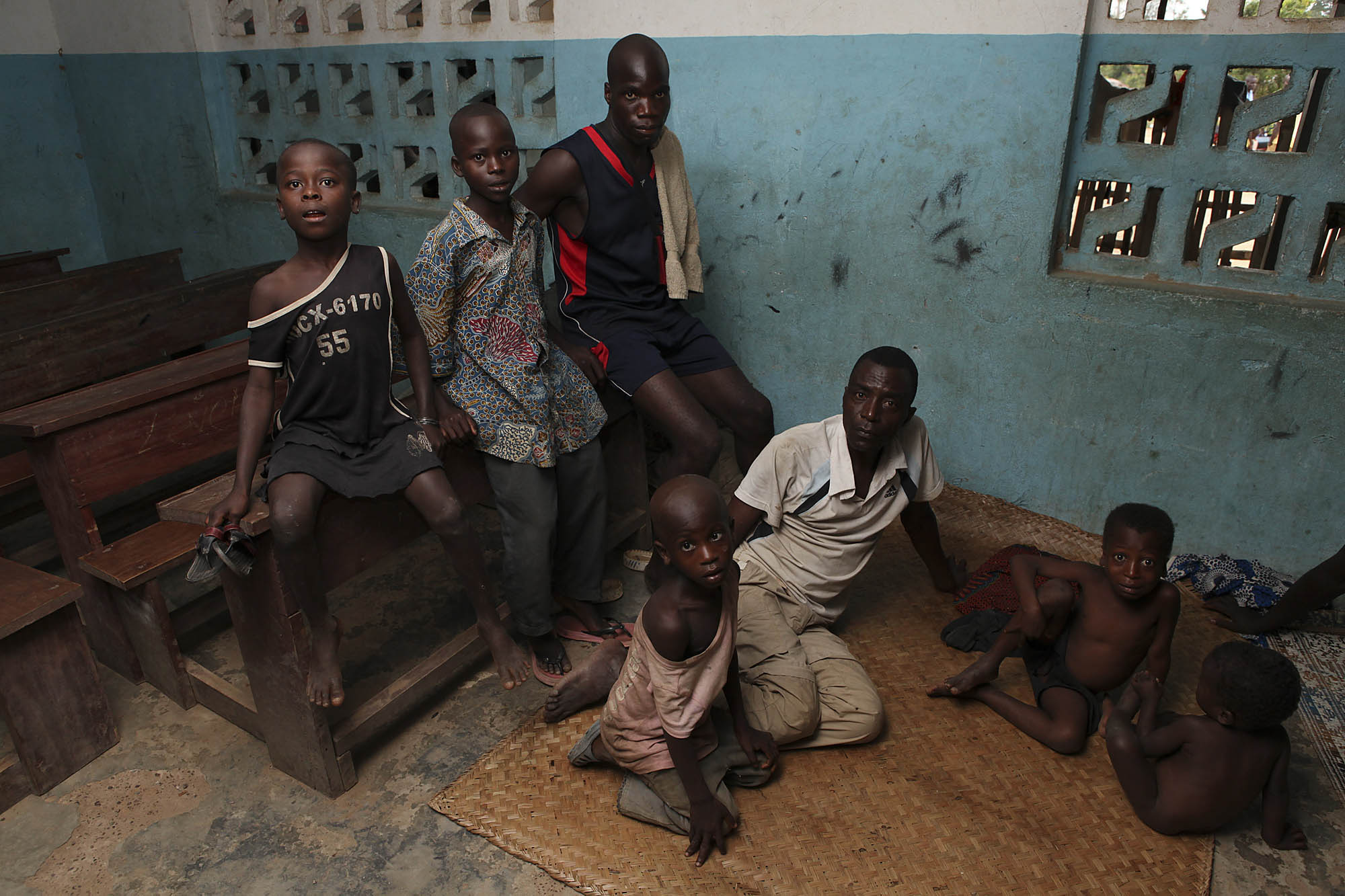 Ivorian refugees shelter in a school room in the town of Jarzon in Grand Gedeh County in Liberia. After the disputed presidential poll in Ivory Coast refugees poured into neighbouring Liberia. REUTERS/Simon Akam (LIBERIA).