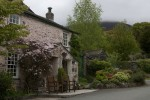 A old house in the village of Applethwaite close to the town on Keswick in the English Lake District.  Above the village the flanks of Skiddaw, the fourth highest mountain in England, rise into the cloud. (Simon Akam for the Washington Post)