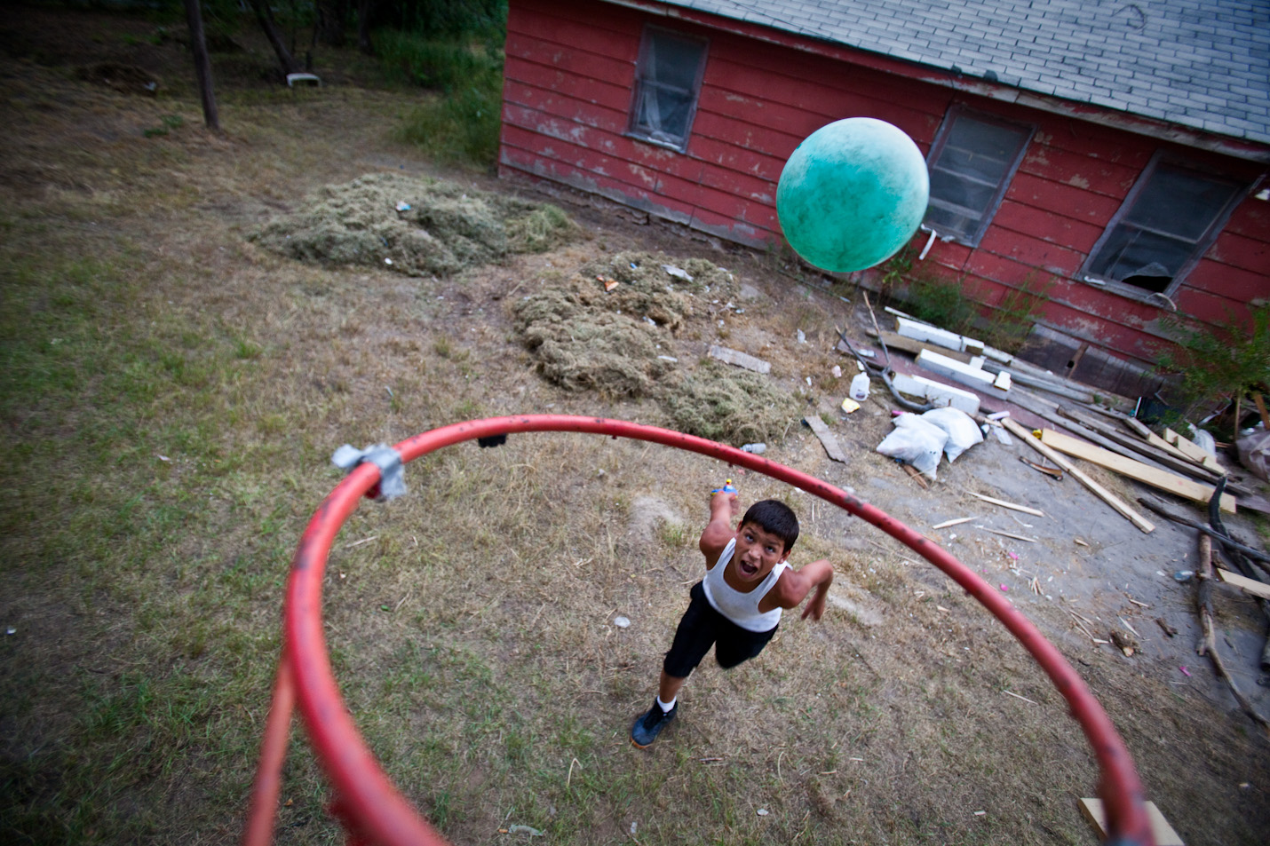 Jordan Anduja plays basketball in his uncle's front yard on the Pine Ridge Reservation in Pine Ridge, South Dakota on Tuesday, July 28, 2009.
