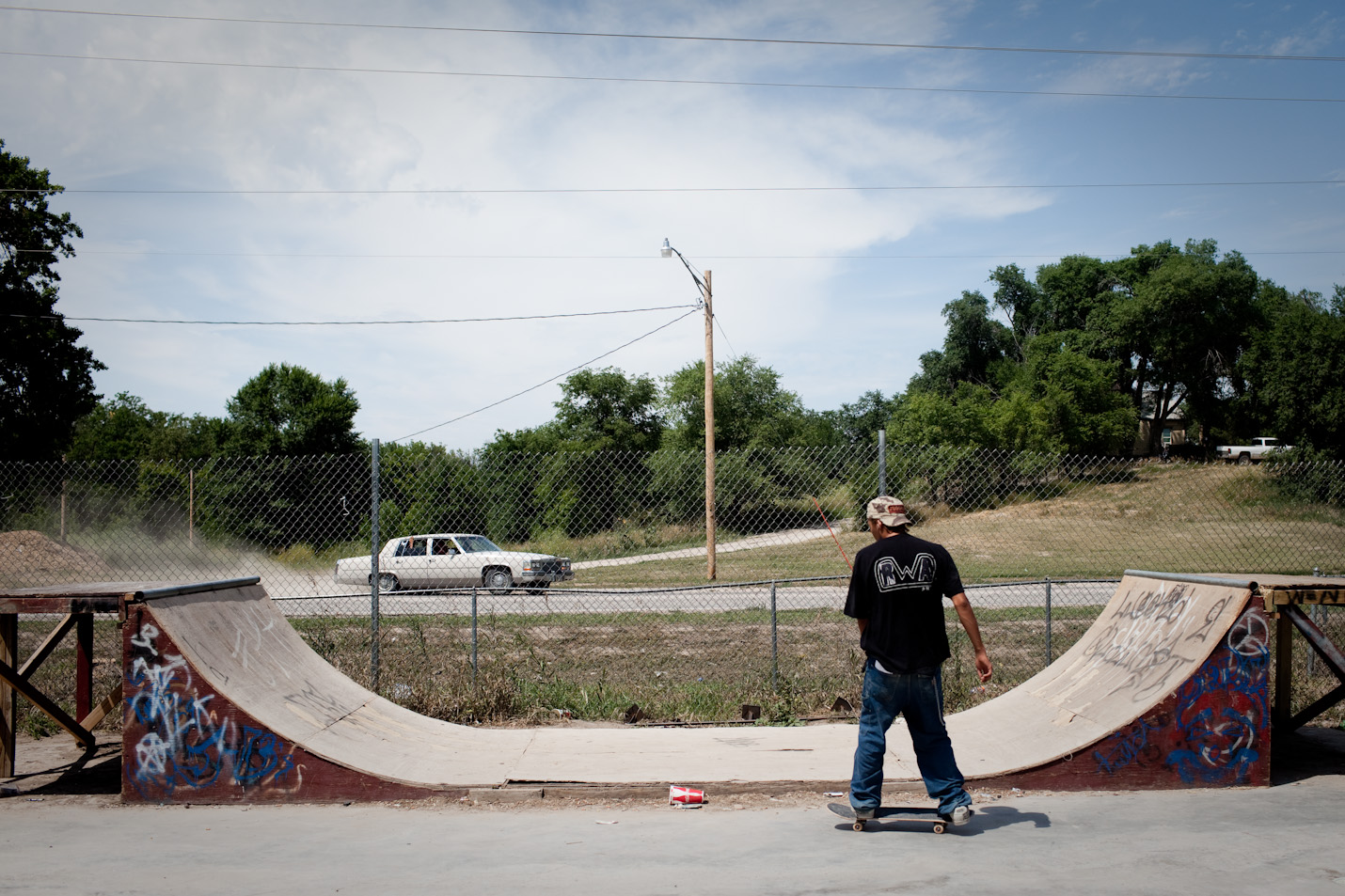 Teens gather at the skate park in the evenings and during the long summer days in Pine Ridge, South Dakota.   Pine Ridge Reservation, located in Shannon County, is considered the poorest county in the United States.  Gang violence, unemployment, and alcoholism are major problems throughout the reservation.