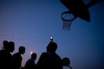 Basketball passes the time on a hot summer night on Pine Ridge Reservation, South Dakota.