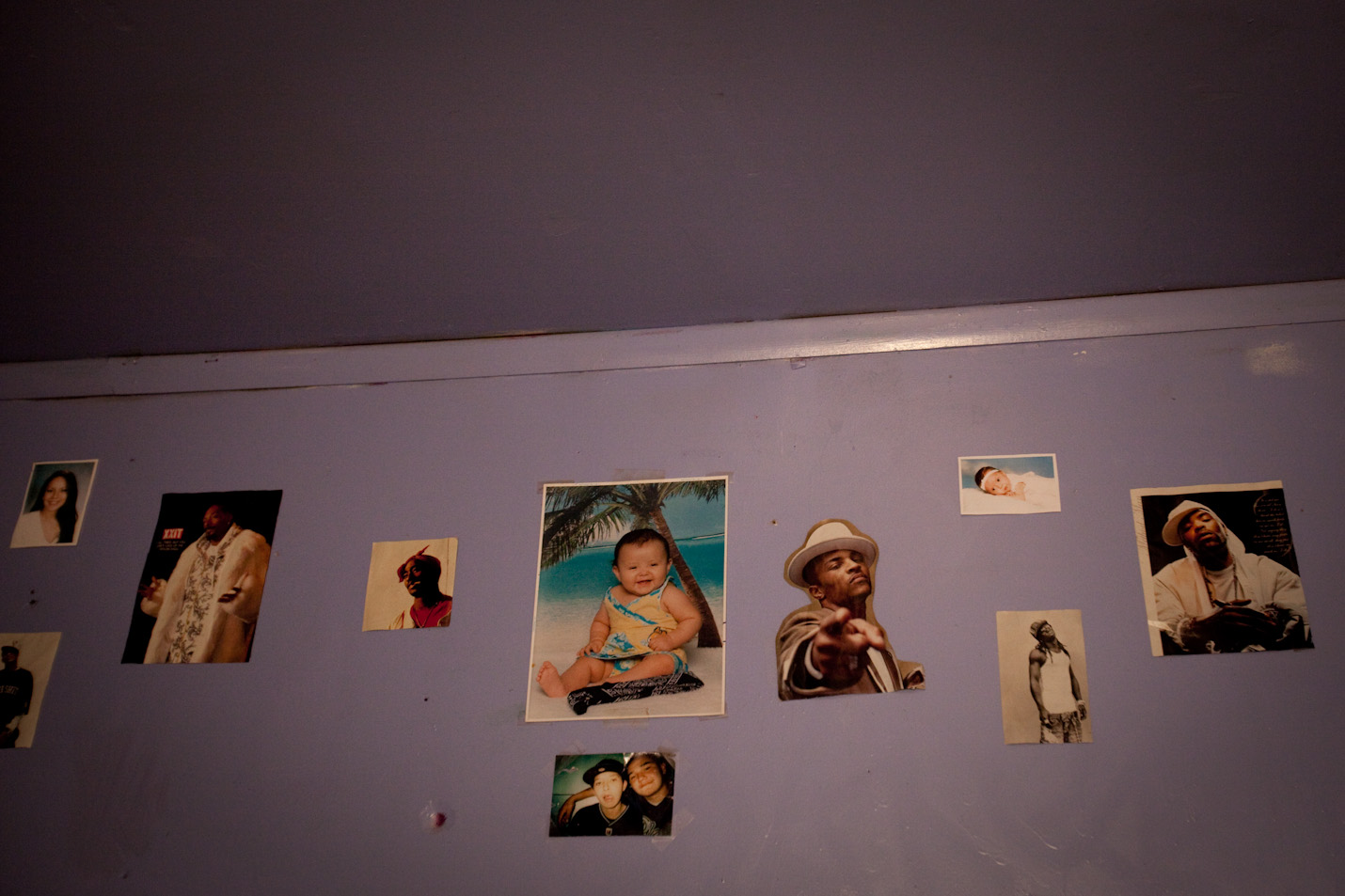 Posters of rappers surround family photographs in June Wilson's room.  June, 17, lives on Pine Ridge Reservation with is family without running water and finds escape in rap music.  Gang violence on the reservation is at an all time high and has created a dangerous environment for young people to grow up in.