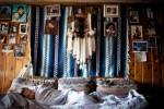 Florence Lone Elk, 23, sleeps in the living room of their house on Pine Ridge Reservation in South Dakota, on Wednesday, October 21, 2009.  Six people reside in the house on a regular basis, which does not have running water or plumbing.