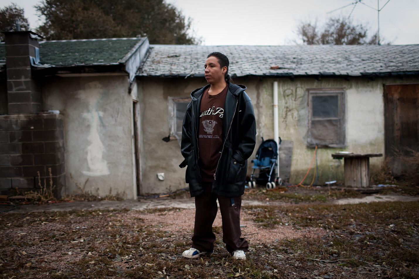 Rich Lone Elk, 24, a member of the North Side Tre Tre Gangsta' Crips, stands outside of his house, in Pine Ridge, South Dakota, on Wednesday, October 21, 2009.  Rich and the rest of his family live without running water or plumbing.