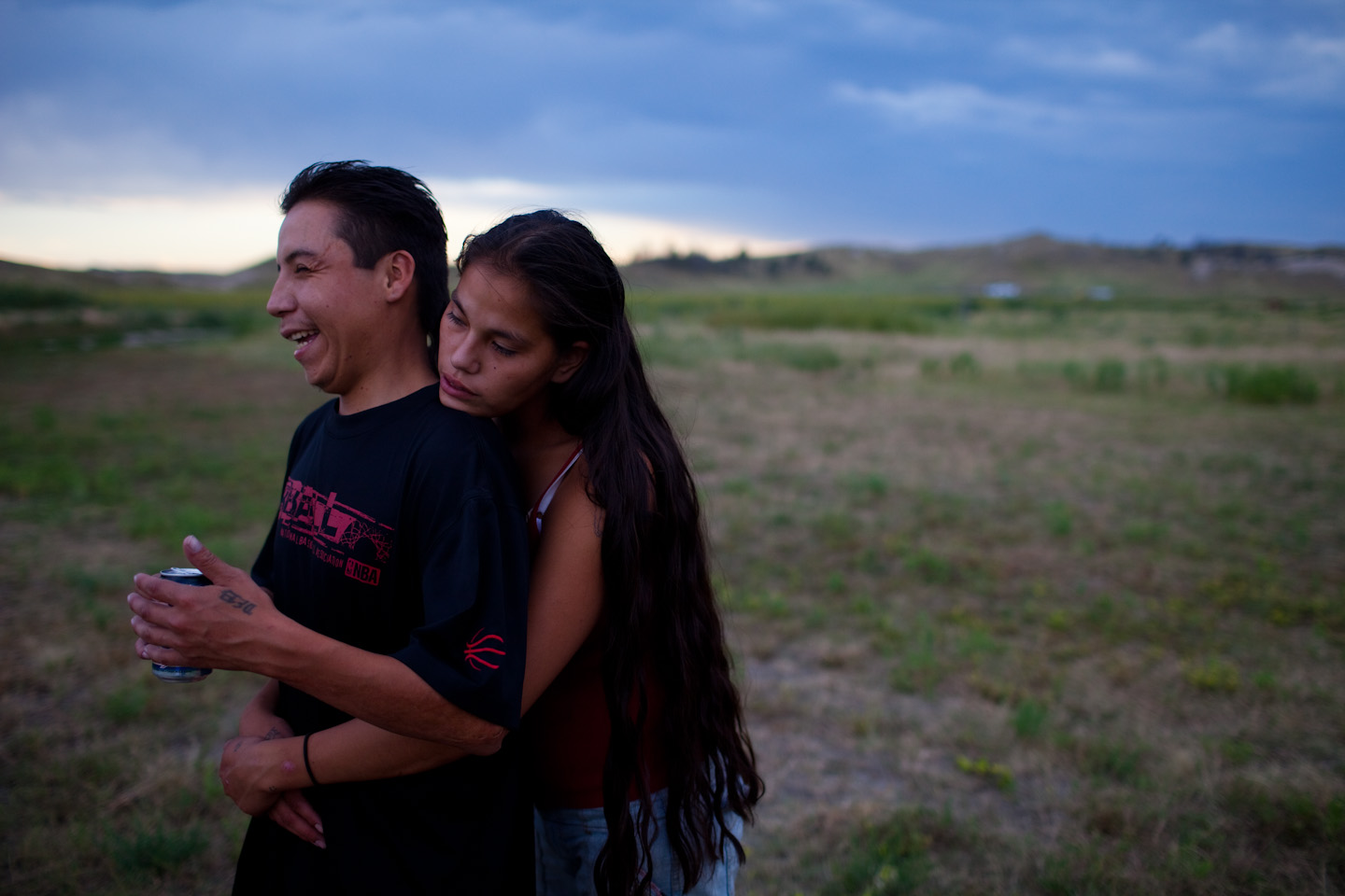 Rich Lone Elk, 24, a member of the North Side Tre Tre Gangsta' Crips, hugs one of his girlfriends, Alexis Oxendine at their house in Pine Ridge, South Dakota.  (Photo by Matthew Williams/ZUMA Press)