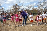 Lance instructs daughter Bella and friend Riley where to run before their cross country meet.