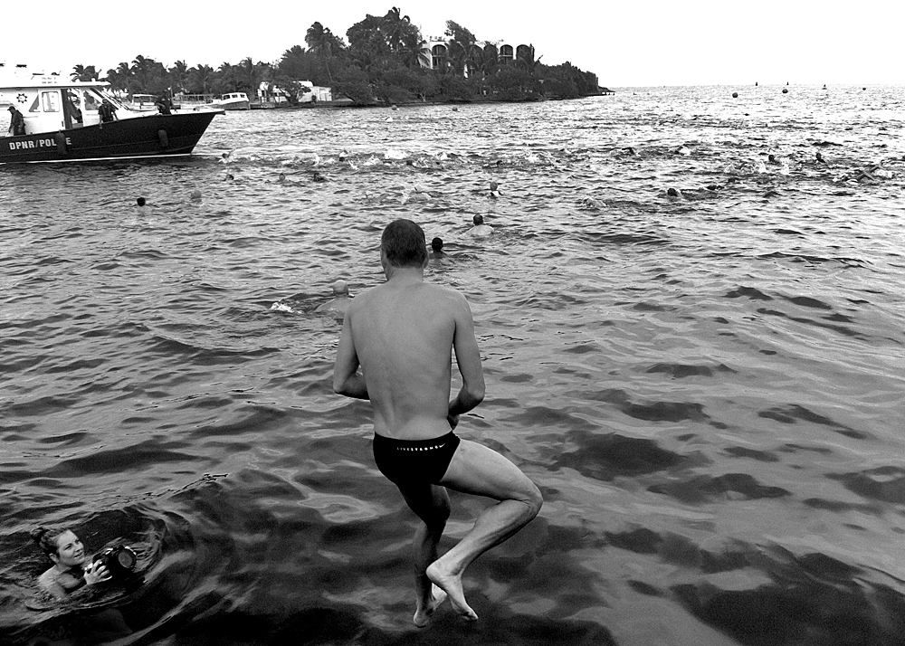 Catching Lance as he jumps in to the water for a swim warm-up for the St. Croix traihtlon
