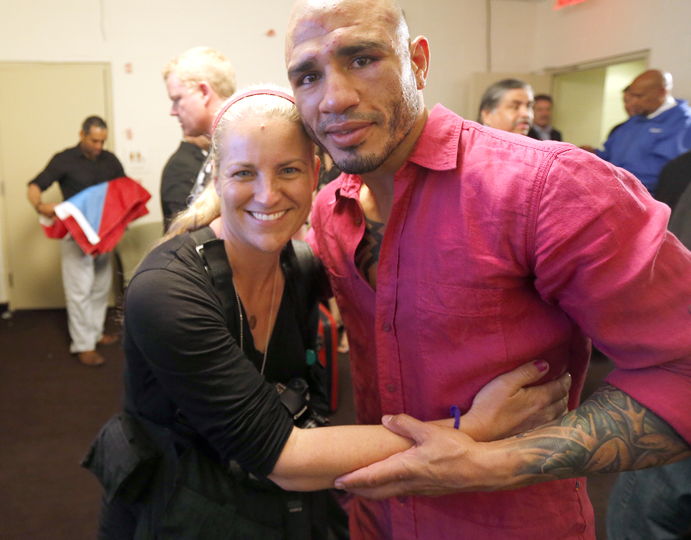 Happy to give the Champ Miguel Cotto a hug after his hard fought TKO win over Sergio Martinez at Madison Square Garden in New York City June 7, 2014
