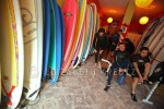 The guys suit up for a team building surfing lesson